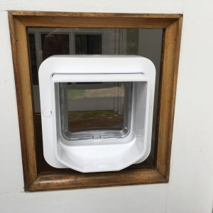 Micro-chipped cat-flap fitted in clear perspex