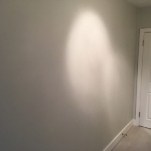 Bare wall before mirror are fitted