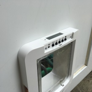 Small microchip dog-flap fitted in door infill panel