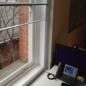Secondary glazing fitted in office.