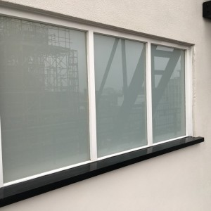 White laminated in window